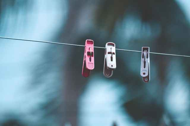 three clothespins on clothesline